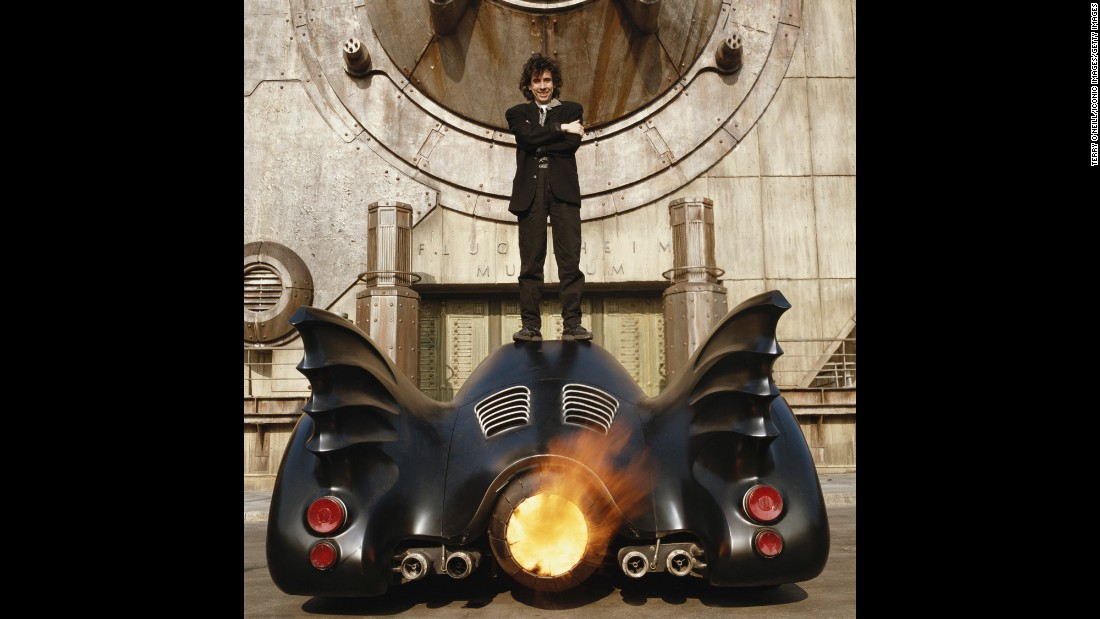 Burton stands on top of the Batmobile at Pinewood Studios in England.