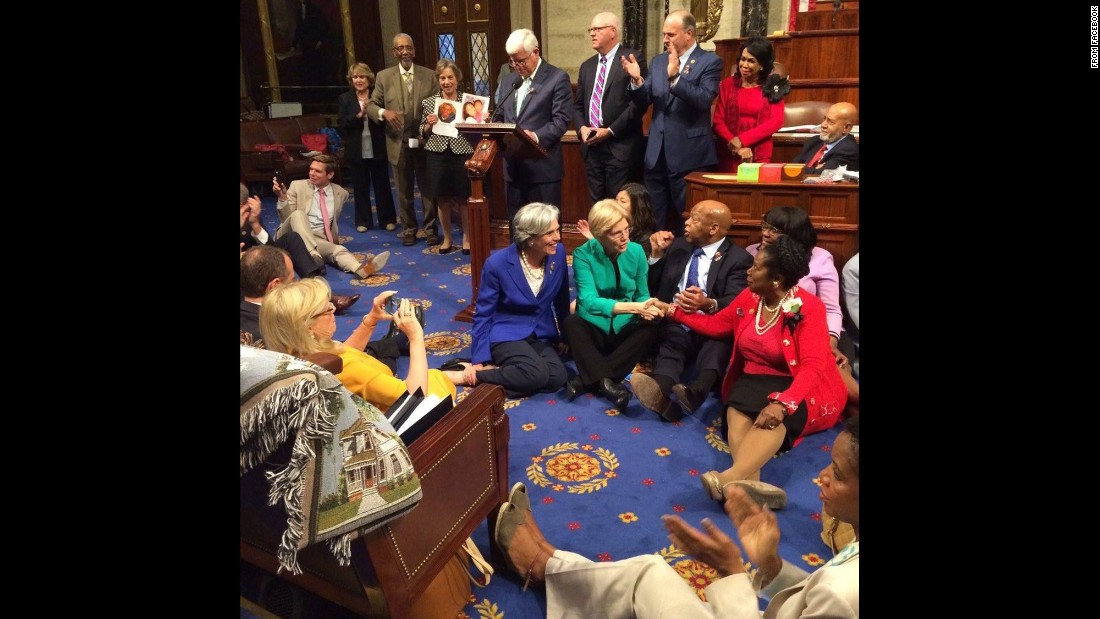 House Democrats sit on the House floor as they try to force a vote on gun control measures on Wednesday, June 22. The sit-in ended a day later, after the House GOP adjourned for a recess.