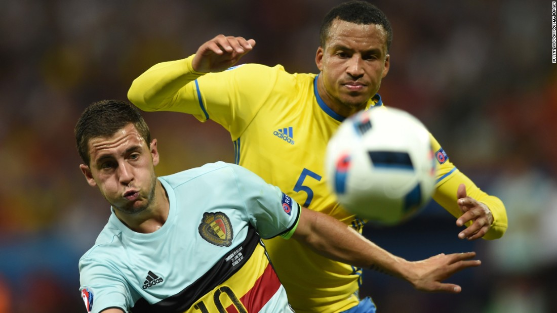 Belgium's Eden Hazard, left, eyes the ball near Sweden's Martin Olsson.