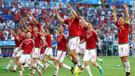 Hungary's players celebrate winning Group F after its 3-3 draw with Portugal.