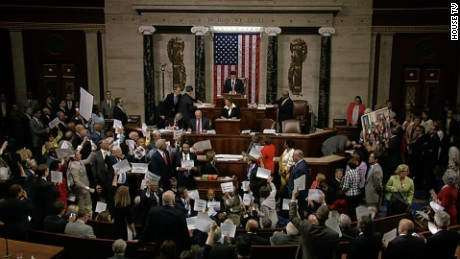 Democrats shout 'no bill, no break' on House floor