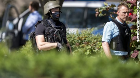 VIERNHEIM, GERMANY - JUNE 23: Heavily-armed police stand outside the movie theatre Kinopolis where an armed man has reportedly opened fire on June 23, 2016 in Viernheim, Germany. According to initial media reports, the man entered the cinema today at approximately 3pm, fired a shot in the air and barricaded himself inside. (Photo by Alexander Scheuber/Getty Images)