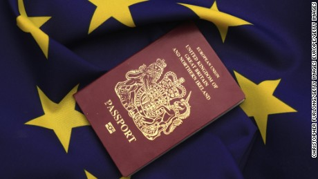 KNUTSFORD, UNITED KINGDOM - MARCH 17:  In this photo illustration, a United Kingdom EU passport sits on a European Union flag on March 17, 2016 in Knutsford, United Kingdom. The United Kingdom will hold a referendum on June 23, 2016 to decide whether or not to remain a member of the European Union (EU), an economic and political partnership involving 28 European countries which allows members to trade together in a single market and free movement across its borders for citizens.  (Photo by illustration by Christopher Furlong/Getty Images)