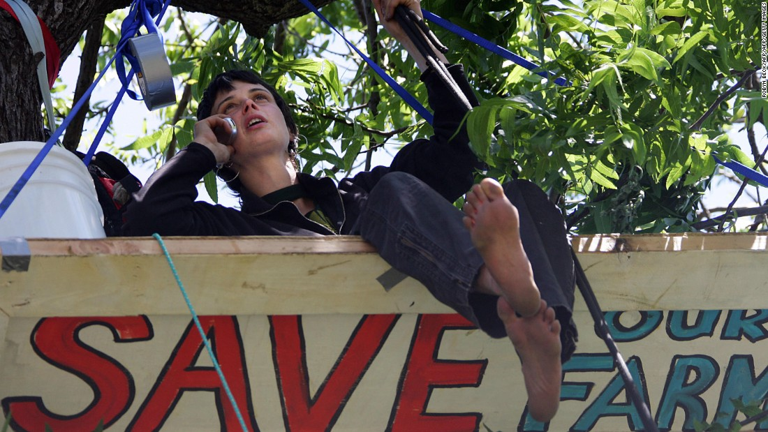 """In 1997, environmental activist Julia Hill began a two-year sit-in, <a href=""""http://www.cnn.com/TECH/science/9806/22/record.treesitter/"""">living in a California redwood tree</a> to protest logging. Here, she is pictured in a similar 2006 effort."""
