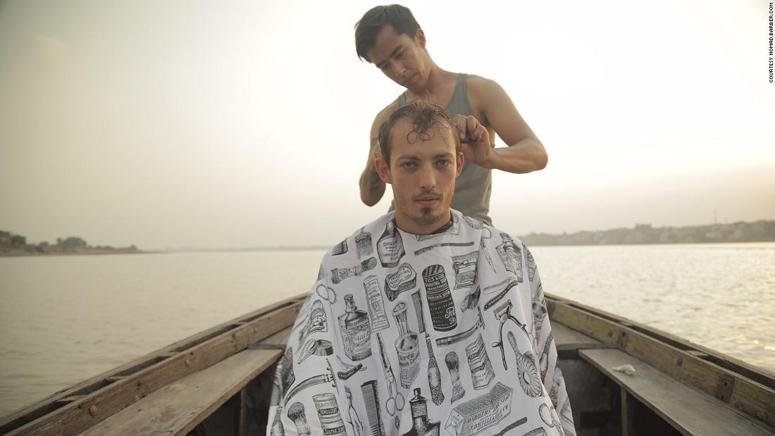 Gutierrez offered a haircut in Varanasi, known as the spiritual capital of India, afloat on the sacred Ganges River.