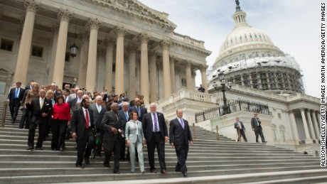 House members led by Minority Leader Nancy Pelosi (D-CA) and James Clyburn (D-SC), walk down the East Front of the U.S. Capitol building to speak with supporters on June 23, 2016 in Washington, DC.