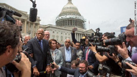 Rep. John Lewis (D-GA), left, Minority Leader Nancy Pelosi (D-CA), center, and Charles Rangel,  (D-NY), right, speak with supporters outside the U.S. Capitol building June 23, 2016 in Washington, DC.