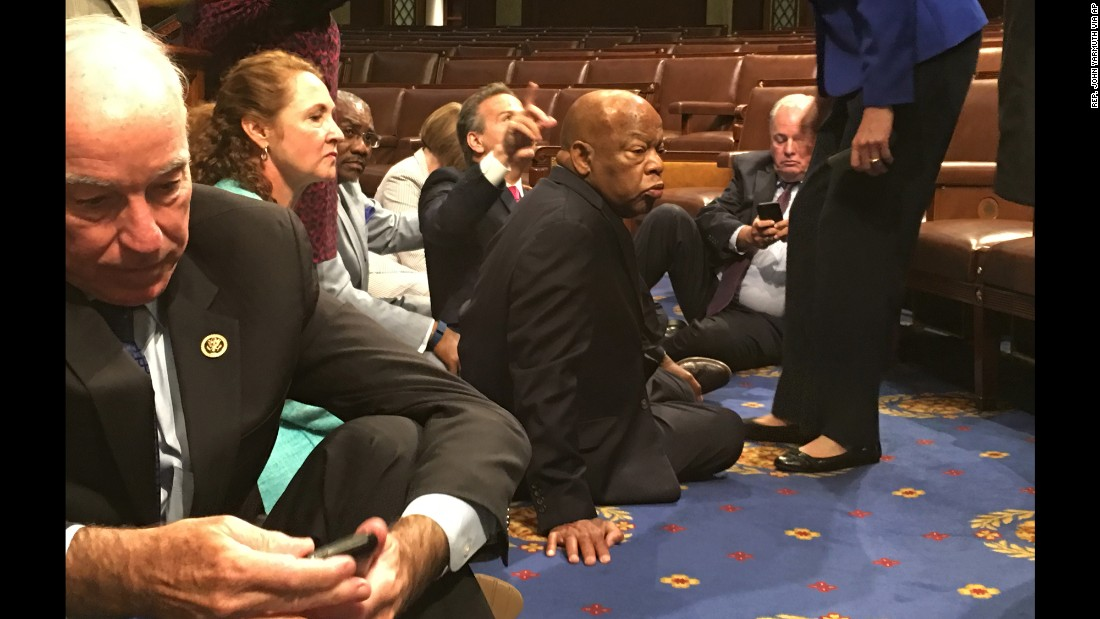 "U.S. Rep. John Lewis, center, sits with other Democrats on the House floor as they try to force a vote on gun control measures on Wednesday, June 22. Lewis, a civil-rights icon, launched the protest in the wake of the Orlando nightclub shooting -- the deadliest mass shooting in U.S. history. ""We have turned deaf ears to the blood of the innocent and the concern of our nation,"" he said on Facebook. ""We will use nonviolence to fight gun violence and inaction."" The sit-in <a href=""http://www.cnn.com/2016/06/22/politics/john-lewis-sit-in-gun-violence/index.html"" target=""_blank"">ended a day later,</a> after the House GOP swiftly adjourned for a recess, but Lewis said the fight was not over."