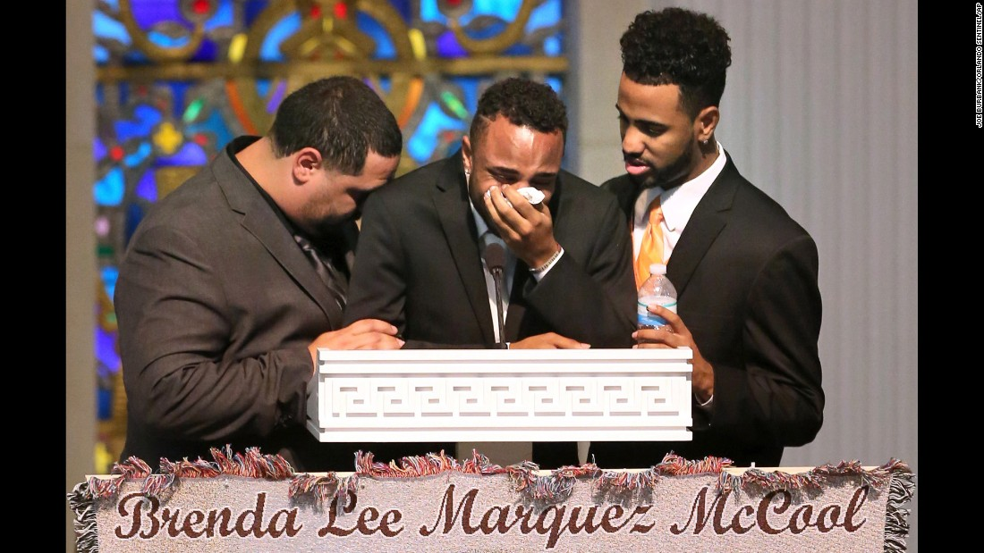 """Michael Marquez, Isaiah Henderson and Robert Presley grieve during the funeral of their mother, Brenda Lee Marquez McCool, at a church in Orlando on Monday, June 20. She was one of <a href=""""http://www.cnn.com/interactive/2016/06/us/orlando-attack-victims/"""" target=""""_blank"""">the 49 people killed</a> in the Orlando nightclub shooting earlier this month. Henderson, center, was at the nightclub with her when she was shot."""