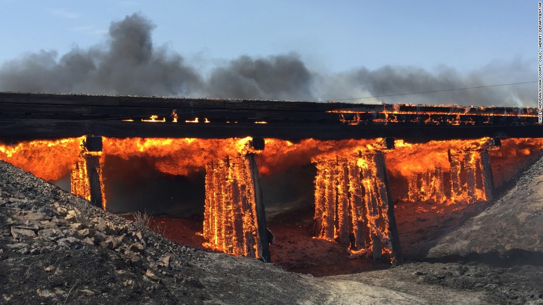 "A railroad trestle burns near Haswell, Colorado, on Wednesday, June 22. More than a dozen wildfires have popped up throughout the Southwest as the region <a href=""http://www.cnn.com/2016/06/21/us/fires-heat-wave-southwest-united-states/index.html"" target=""_blank"">battles a lethal heat wave.</a>"