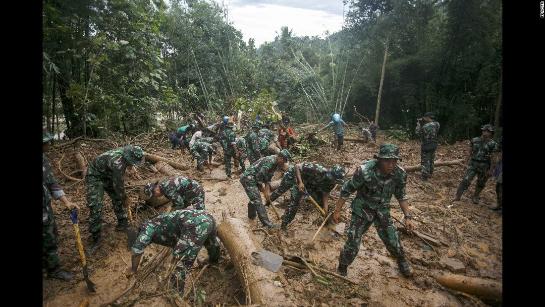 "Soldiers search for landslide victims in Purworejo, Indonesia, on Sunday, June 19. At least 35 people died after heavy rains and floods <a href=""http://www.cnn.com/2016/06/19/asia/indonesia-central-java-landslides/"" target=""_blank"">triggered landslides</a> in the province of Central Java."