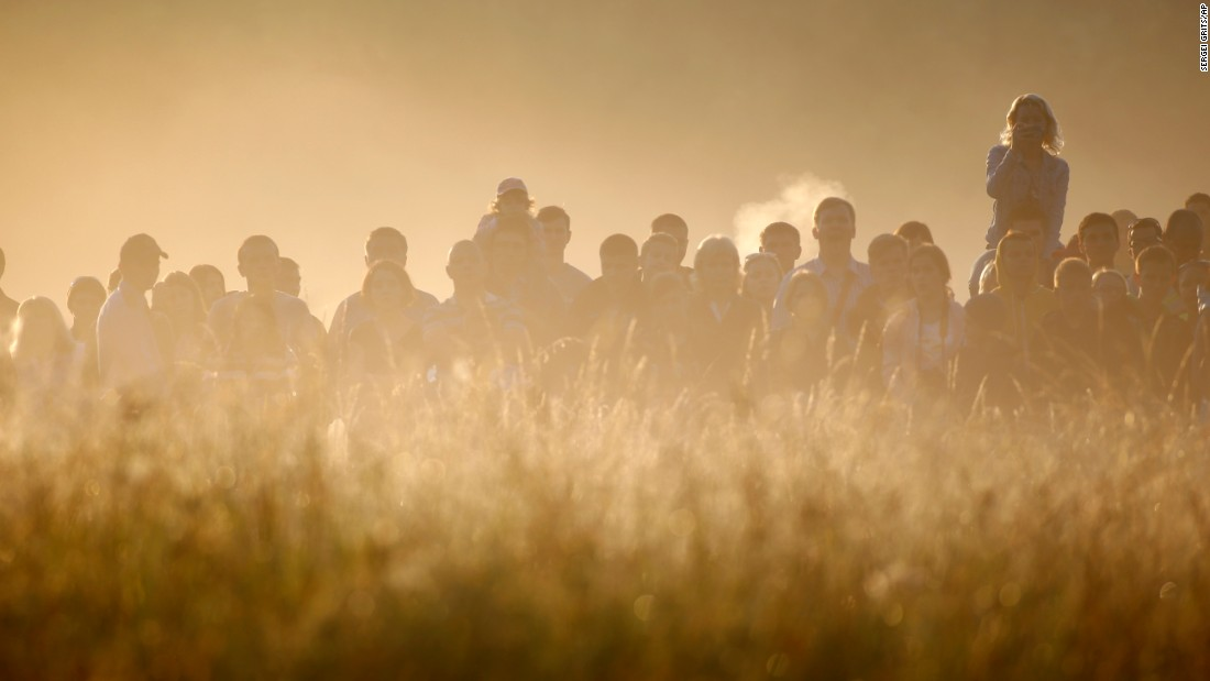 Spectators surrounded by morning fog watch battle re-enactments in Brest, Belarus, on Wednesday, June 22. It was the Day of Remembrance and Sorrow, 75 years after Germany attacked the Soviet Union during World War II.