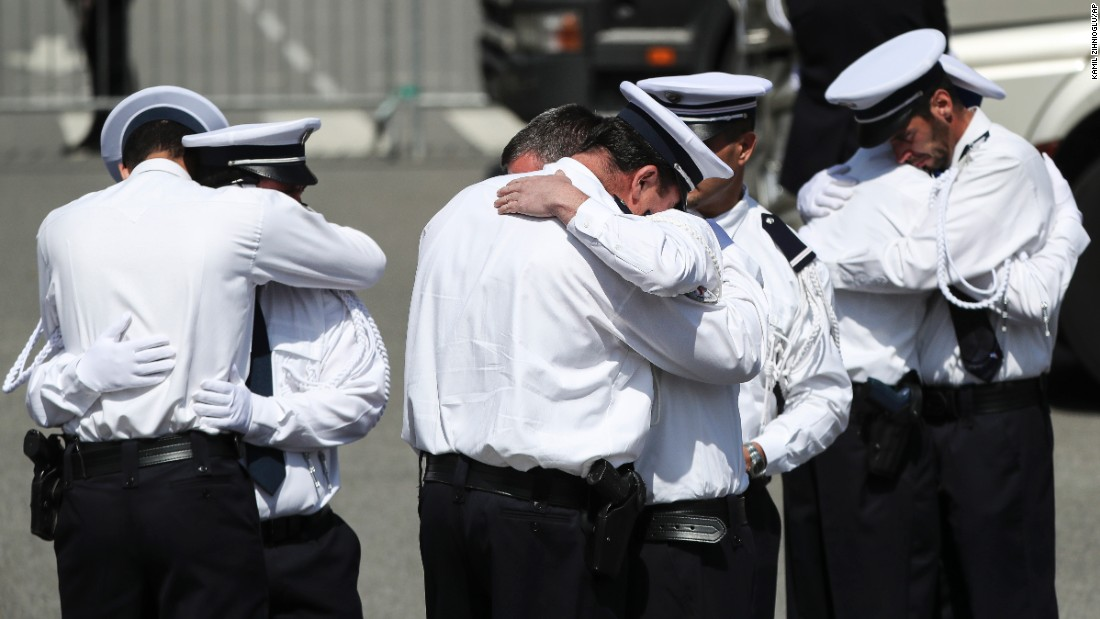 "Police officers in Versailles, France, hug Friday, June 17, as they pay their final respects to Jean-Baptiste Salvaing and Jessica Schneider. Salvaing, a police commander, and Schneider, a civil servant who worked at a local police station, <a href=""http://www.cnn.com/2016/06/16/europe/france-magnanville-terror-missed-signals-lister/"" target=""_blank"">were killed at their home outside Paris</a> earlier in the week. The killer, who was shot dead by a SWAT team, declared his allegiance to the ISIS militant group in a video he recorded after taking over the couple's home."