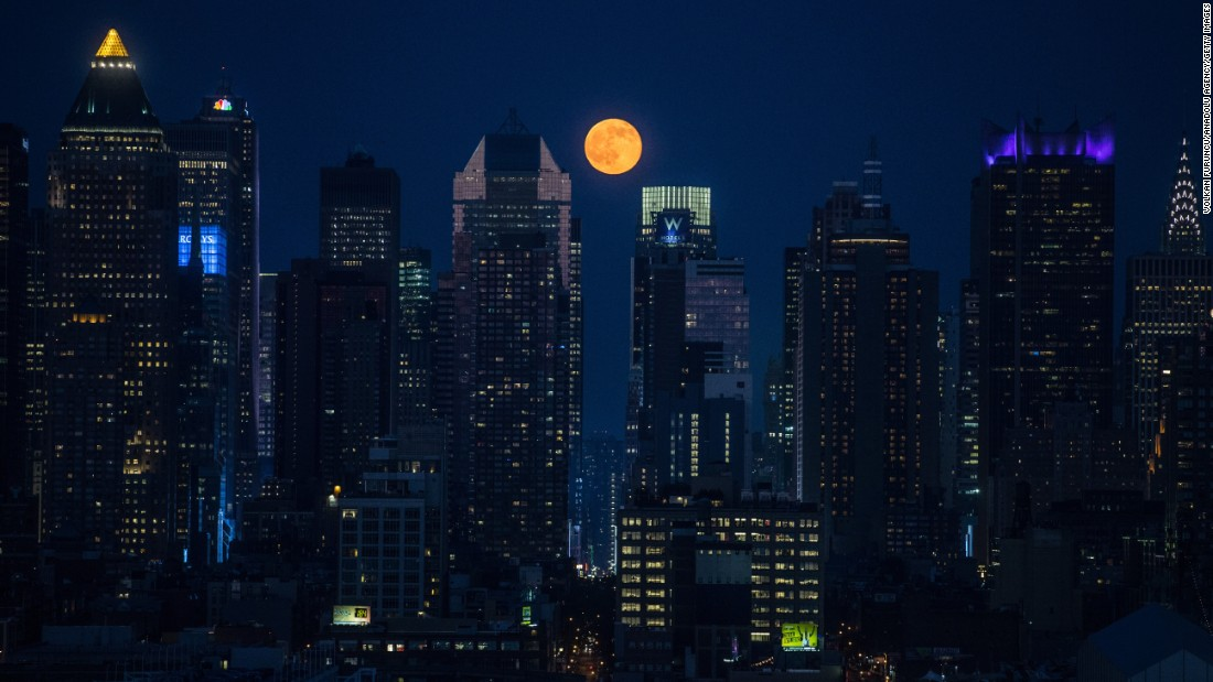 """A full moon rises above skyscrapers in New York on Monday, June 20. The <a href=""""http://www.cnn.com/2016/06/20/health/summer-solstice-strawberry-moon-irpt/"""" target=""""_blank"""">""""strawberry moon""""</a> coincided with the summer solstice for the first time since 1967."""
