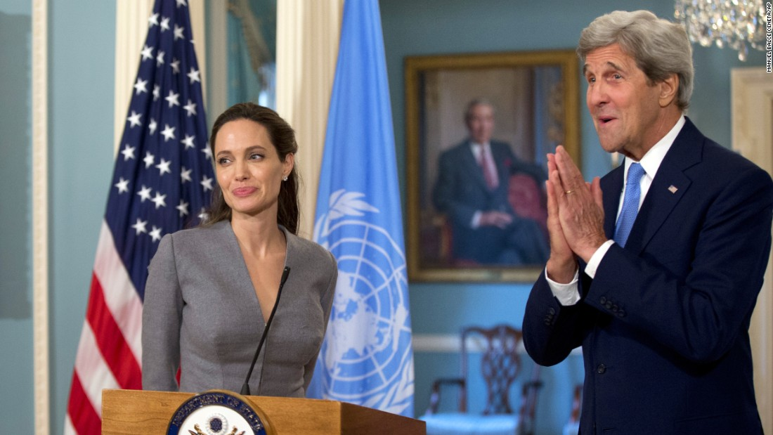 "U.S. Secretary of State John Kerry meets with actress <a href=""http://www.cnn.com/2013/05/14/showbiz/gallery/angelina-jolie/index.html"" target=""_blank"">Angelina Jolie, </a>special envoy for the United Nations' refugee agency, at the State Department in Washington on Monday, June 20. Both delivered statements on what was World Refugee Day. ""I ask people to understand that with 65 million people displaced by conflict, we are facing a world of wars we cannot ignore or turn our backs on,"" Jolie said. ""To do that would be naive, irresponsible, and dangerous."""