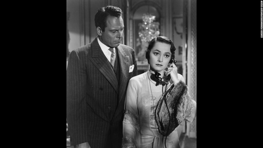 "De Havilland was off the screen for nearly three years while she battled Warner Bros. After winning her court case, she was free to chart her own career and scored her first Academy Award in ""To Each His Own"" (1946), here with Bill Goodwin. The part required a greater range from her than earlier roles as she matured from a young unwed mother into a older career woman."