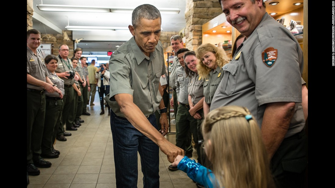 U.S. President Barack Obama fist-bumps a young girl Friday, June 17, as he and his family toured Carlsbad Caverns in New Mexico.