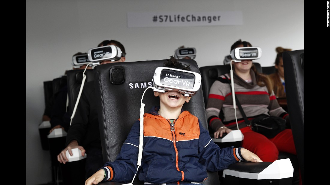 A boy plays a virtual-reality game in Paris on Sunday, June 19.