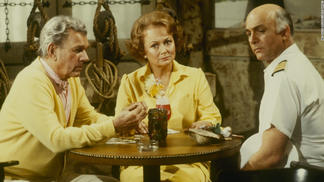 "De Havilland joined the parade of older stars who made guest appearances on the popular ABC TV series ""The Love Boat."" Here, she appears with series star, Gavin MacLeod, right, and Joseph Cotten in a 1981 episode. The actress earlier had starred with Cotten in ""Hush ... Hush, Sweet Charlotte"" (1964)."