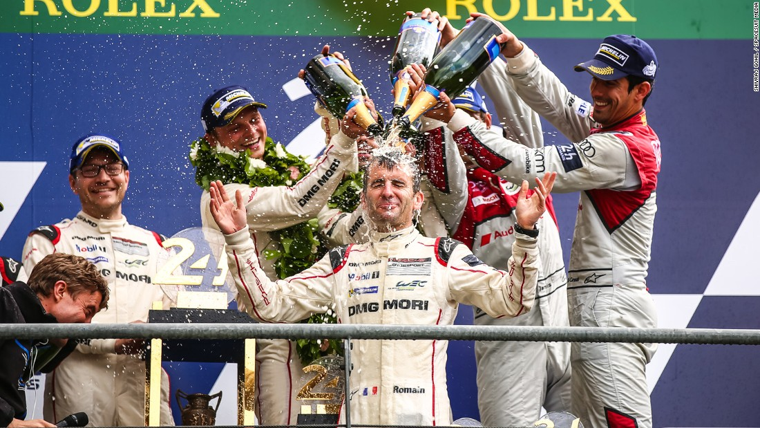 The Porsche team, which included Lucas di Grassi (far right), were gifted the win this year after the Toyota team broke down on the last lap.