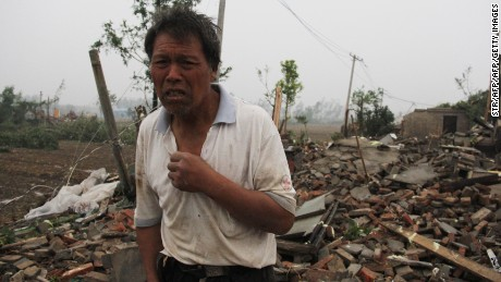 A man walks through the rubble of destroyed houses after a tornado in Funing, in Yancheng, in China's Jiangsu province on June 23, 2016.  Extreme weather, including hailstorms, heavy rain and a tornado, killed 51 and injured dozens in China's eastern Jiangsu province, the official Xinhua news agency reported on June 23.  CHINA OUT      / AFP / STR        (Photo credit should read STR/AFP/Getty Images)