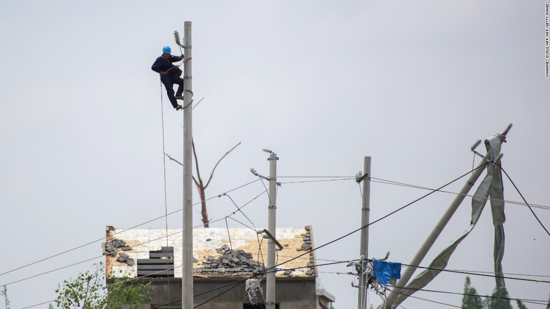 A worker assesses damage to infrastructure on June 24. According to local authorities, the powerful storm hit the region with winds of up to 125 kilometers per hour.