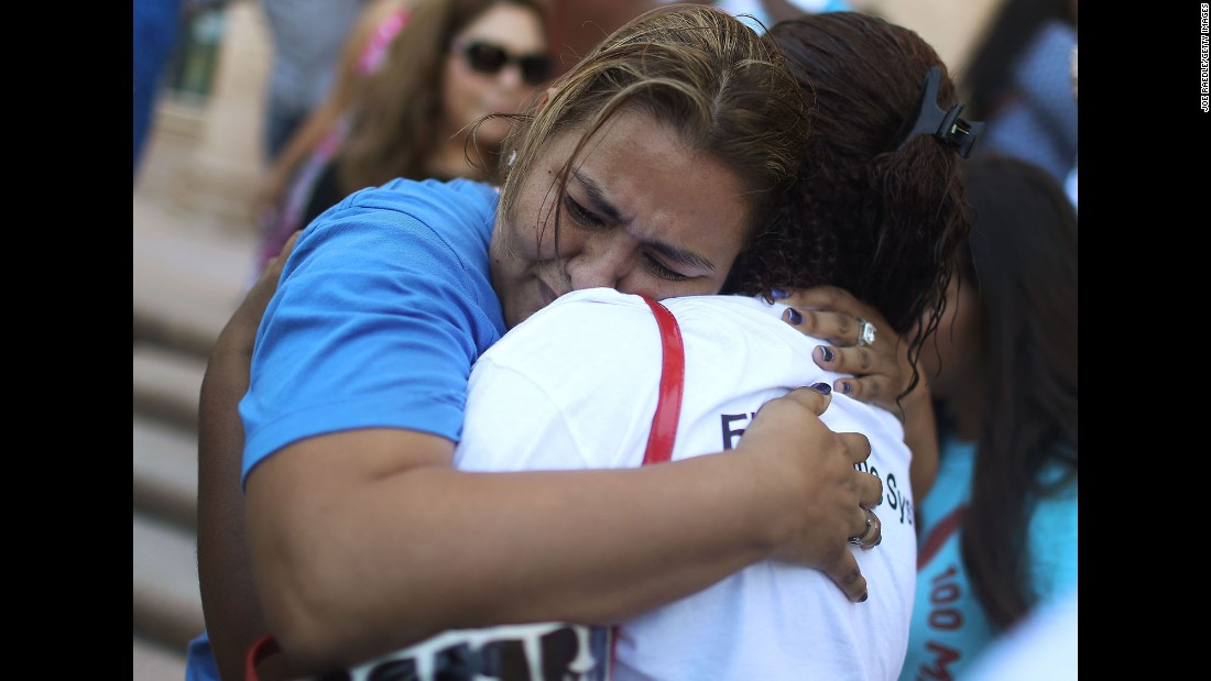 "People comfort each other on the steps of Miami's Freedom Tower on Thursday, June 23, after the U.S. Supreme Court <a href=""http://www.cnn.com/2016/06/23/politics/immigration-supreme-court/"" target=""_blank"">was split</a> on executive actions that President Barack Obama imposed two years ago on immigration. The actions were meant to enable millions of eligible undocumented immigrants to receive temporary relief from the threat of deportation. Immigrants would have also been allowed to apply for programs that could qualify them for work authorization and associated benefits. But the Supreme Court's ruling means that the programs will remain blocked and the issue will return to the lower court."