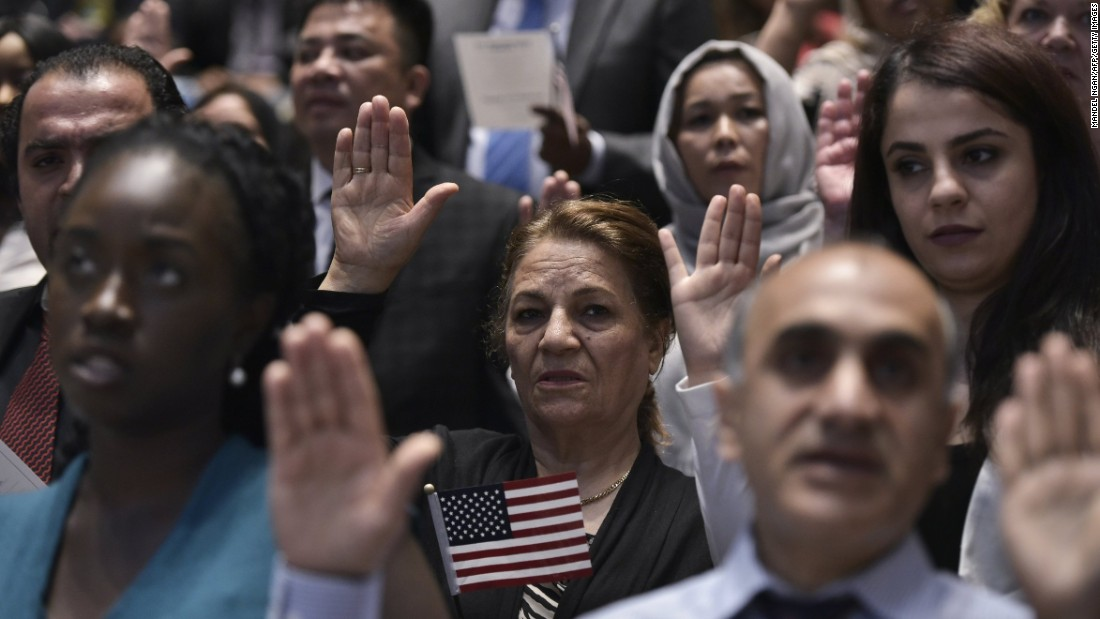 People take part in a naturalization ceremony in Washington on Monday, June 20.