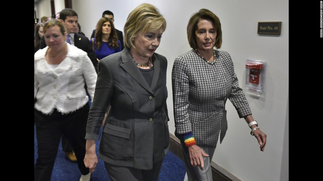 House Minority Leader Nancy Pelosi, right, walks with Democratic presidential candidate Hillary Clinton after a meeting in Washington on Wednesday, June 22.