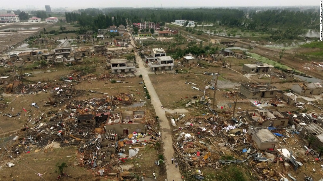 The extent of storm damage is seen across the village of Funing, near Yancheng City in China's Jiangsu Province, on Friday, June 24. Severe weather, including a rare tornado, struck the region on June 23, killing at least 98 people and injuring hundreds.