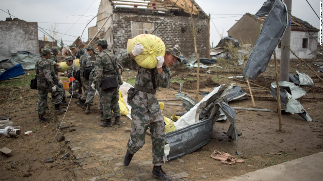 Soldiers work in the rubble of Funing on June 24. According to the Ministry of Civil Affairs, the central government in Beijing has sent a team to oversee disaster relief efforts.