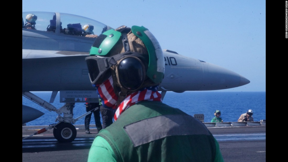 U.S. Navy sailors prepare to launch a fighter jet from the deck of the USS Harry S. Truman on Tuesday, June 7. The aircraft carrier was in the Mediterranean Sea to assist in the fight against the ISIS militant group.