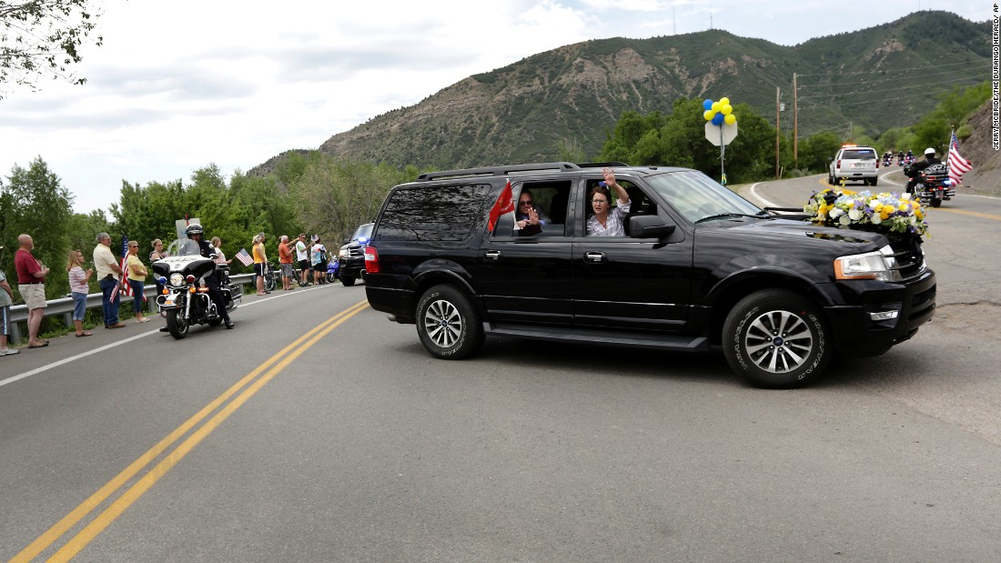 "Family members of U.S. Marine Capt. Jeff Kuss thank people on the way to his funeral in Durango, Colorado, on Saturday, June 11. Kuss, a pilot with the Blue Angels demonstration team, <a href=""http://www.cnn.com/2016/06/03/politics/blue-angels-pilot-identified/"" target=""_blank"">died when his plane crashed during practice</a> in Tennessee. He was 32."