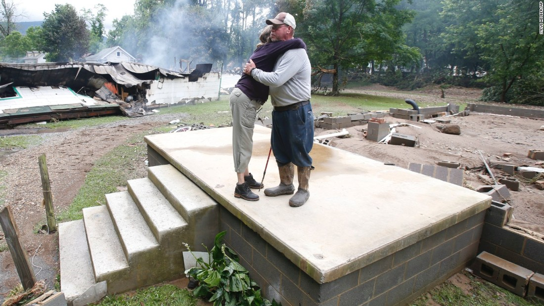 Jimmy Scott gets a hug from Anna May Watson as they clean up in White Sulphur Springs on June 24.
