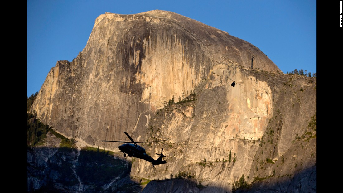 "Marine One is silhouetted against the Half Dome rock formation as the first family arrives at Yosemite National Park on Friday, June 17. <a href=""http://www.cnn.com/2016/05/27/politics/gallery/us-military-may-photos/index.html"" target=""_blank"">See U.S. military photos from May</a>"