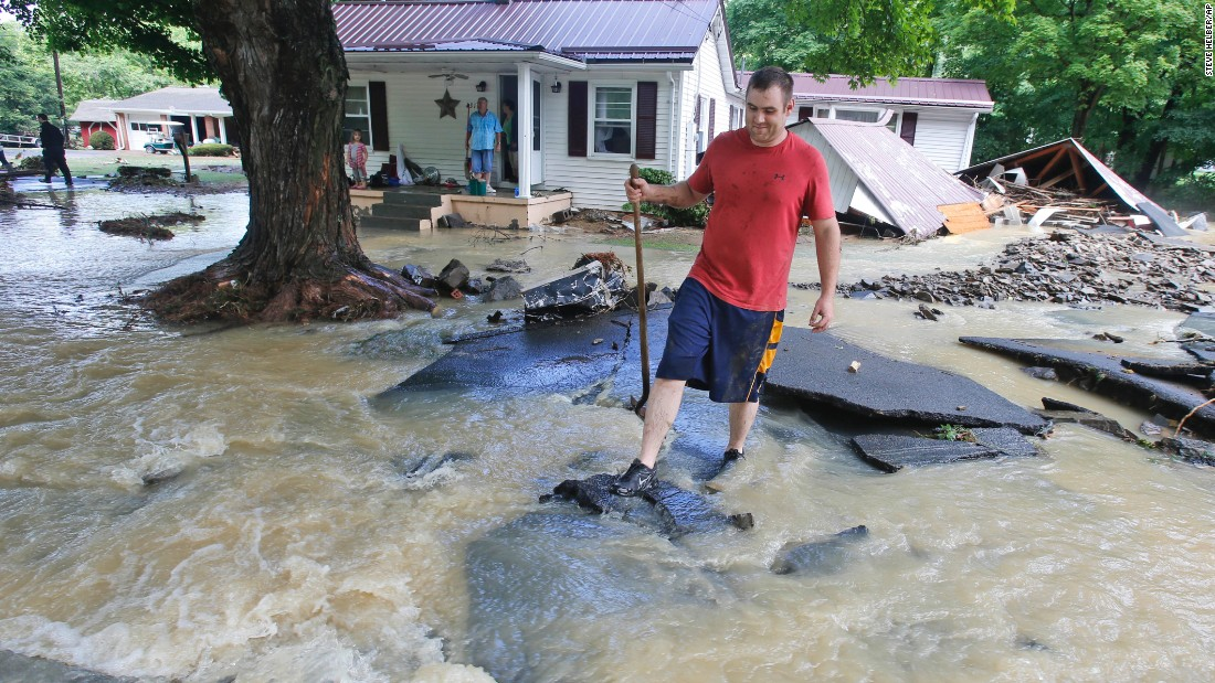 ... to a road after severe flooding in White Sulphur Springs on June 24