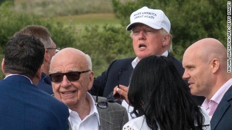 Presumptive Republican presidential nominee Donald Trump (2nd R) leaves with Australian born media magnate Rupert Murdoch (C) after a tour of his International Golf Links course north of Aberdeen on the east coast of Scotland on June 25, 2016.