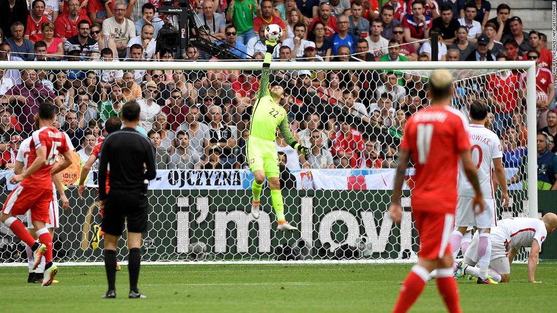 Poland goalkeeper Lukasz Fabianski, center, makes a save.