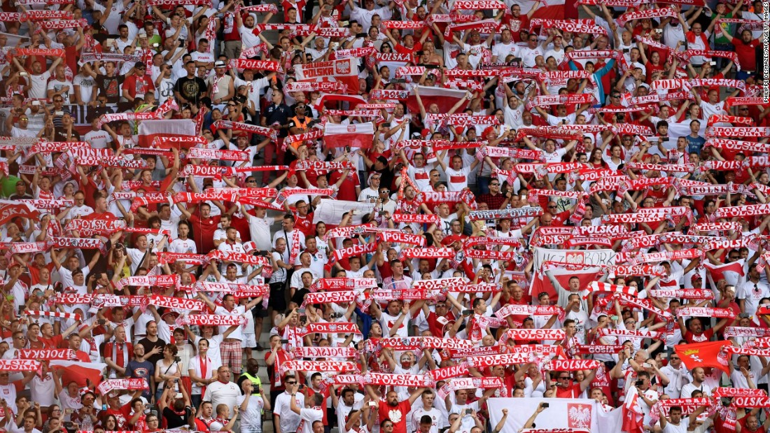 Poland supporters cheer ahead the Euro 2016 Round of 16 football match between Switzerland and Poland.