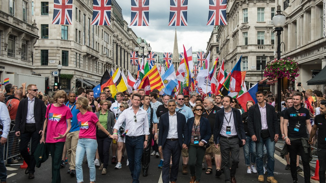 London Mayor Sadiq Khan, center, and his wife Saadiya Khan lead a march during Pride in London on June 25.