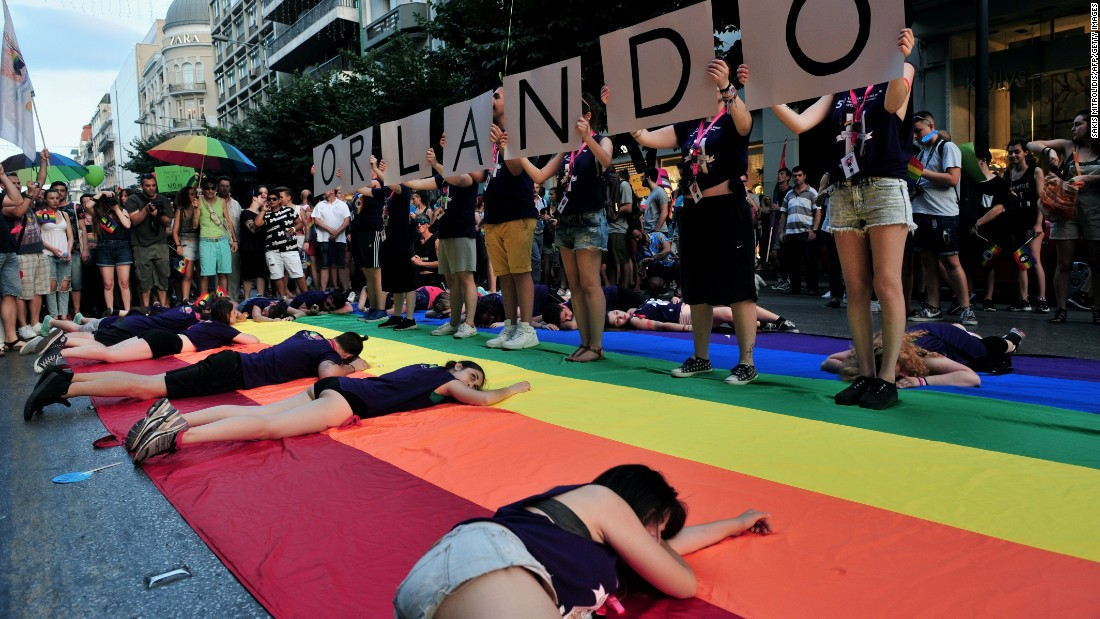 "People hold placards reading ""Orlando"" in memory of the victims of Orlando's gay nightclub shooting as thousands of people parade in the streets of Thessaloniki, Greece, during the city's 5th Gay Pride march on June 25."