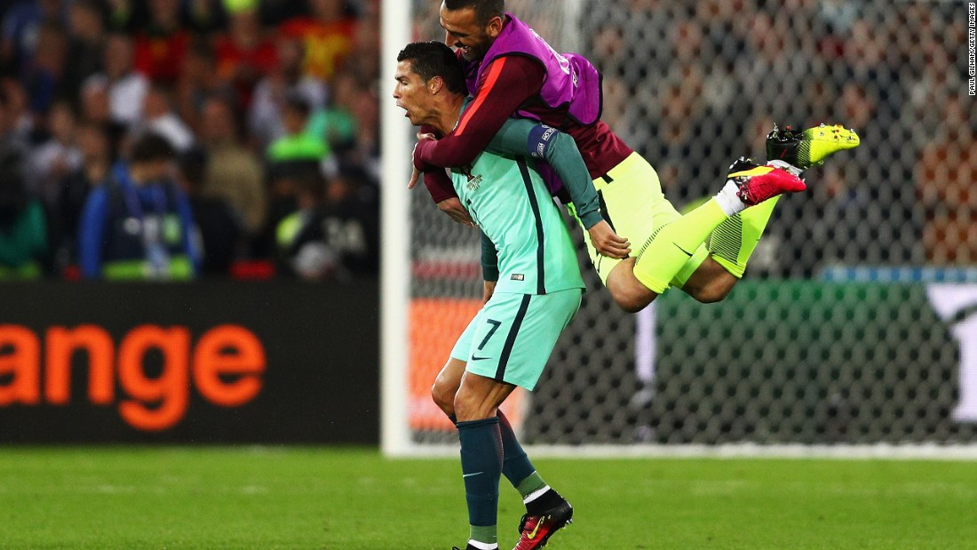 Eduardo jumps to his teammate Cristiano Ronaldo as Portugal celebrates their 1-0 win over Croatia on Saturday, June 25, 2016 at the Bollaert-Delelis stadium in Lens, France.