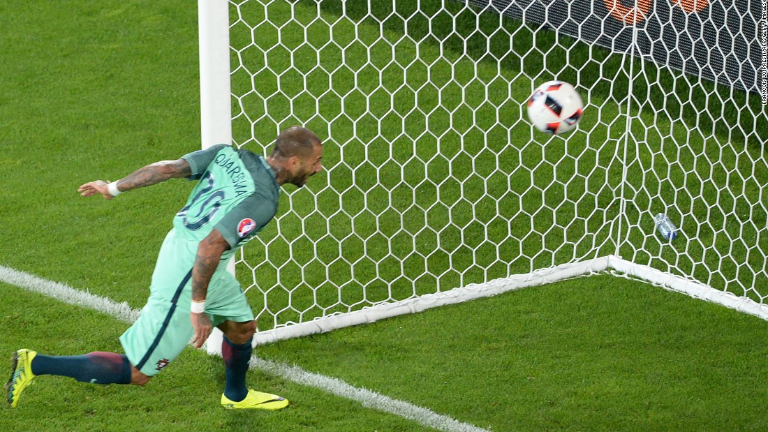 Portugal forward Ricardo Quaresma heads the ball to score a goal in extra time.