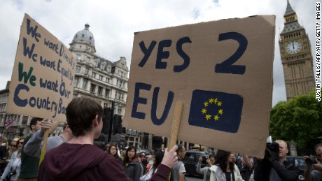 A demonstrator holds a placard during a protest against the outcome of the UK's June 23 referendum on the European Union (EU), in central London on June 25, 2016.
