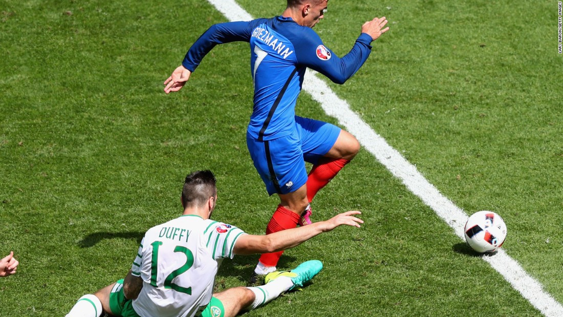 Shane Duffy of Ireland fouls Antoine Griezmann of France, resulting in a red card.