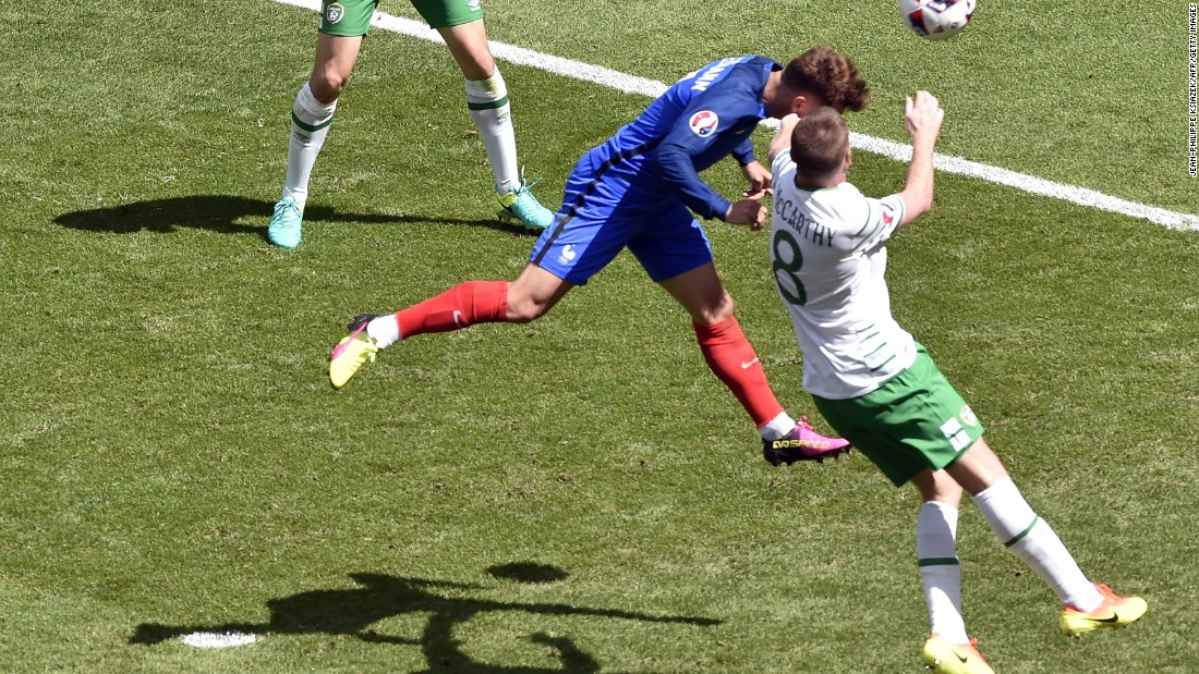 France forward Antoine Griezmann heads the ball to score.