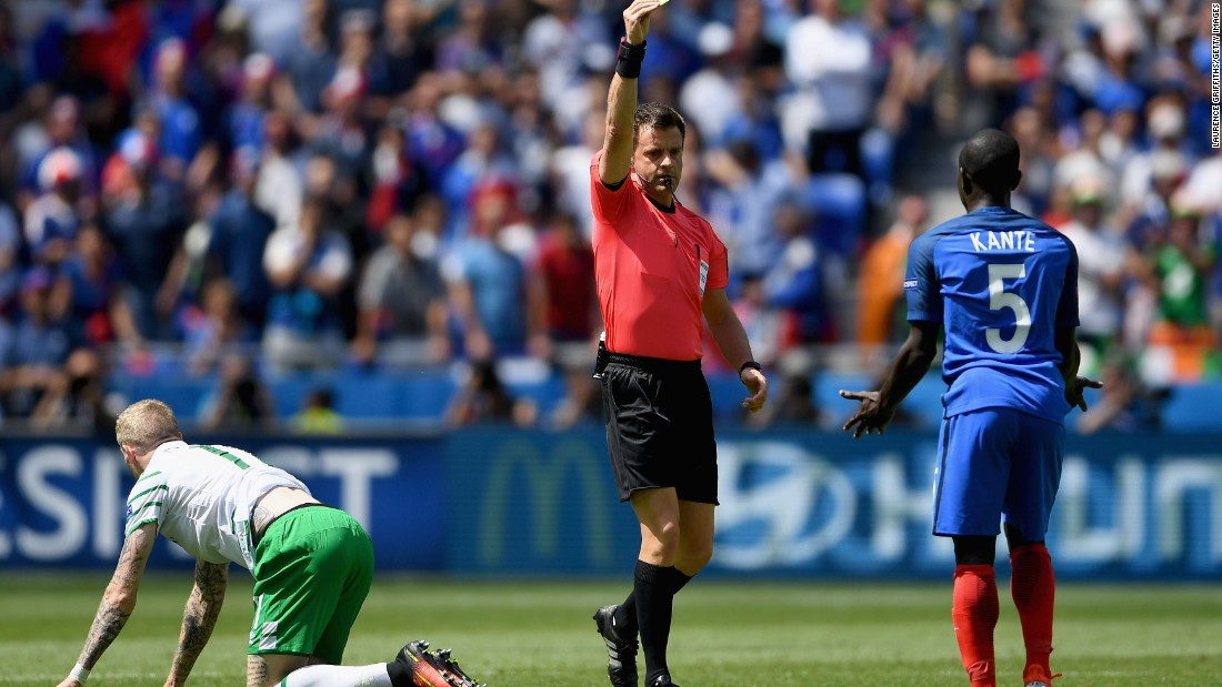 N'Golo Kante of France is shown a yellow card by referee Nicola Rizzoli after fouling James McClean of Ireland.