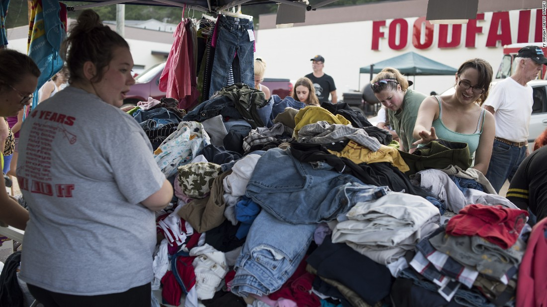 People in Clendenin look through personal items that were brought in as part of a local relief effort on June 25.