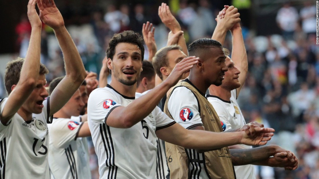 Germany's players celebrate their win. Next they play Italy or Spain.