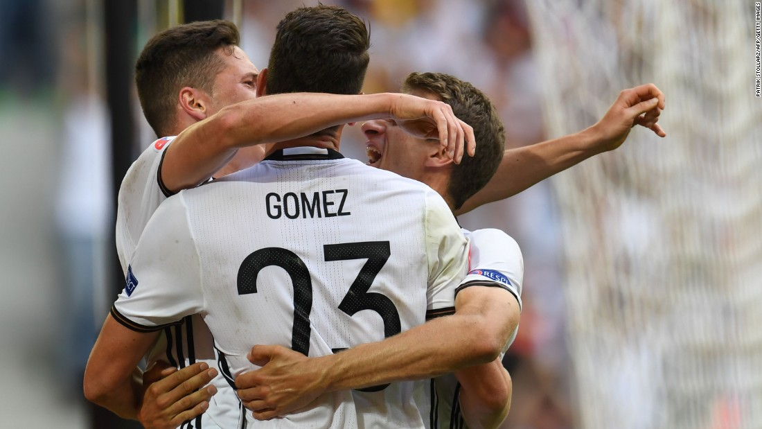 Germany's forward Mario Gomez, center, celebrates with midfielder Julian Draxler and midfielder Thomas Mueller, right, after scoring.